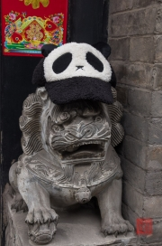 Pingyao 2013 - Hotel lion sculpture with panda hat
